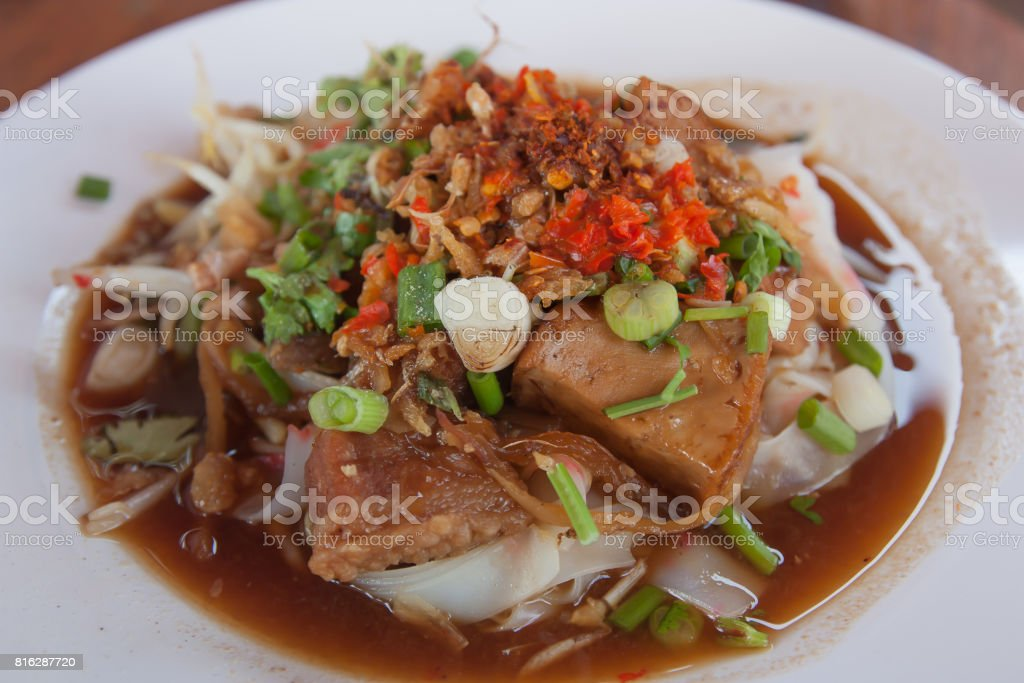 Noodle tube with vegetables and in noodle tube on the dish. stock photo