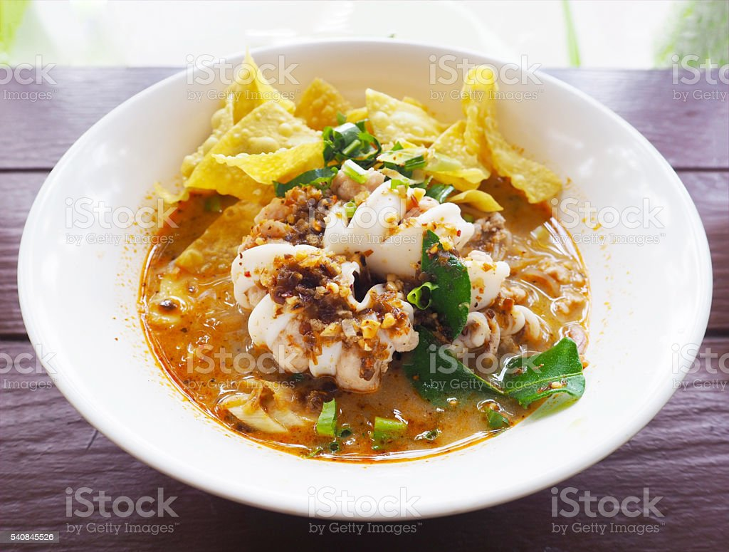 noodle with hot and spicy seafood soup stock photo