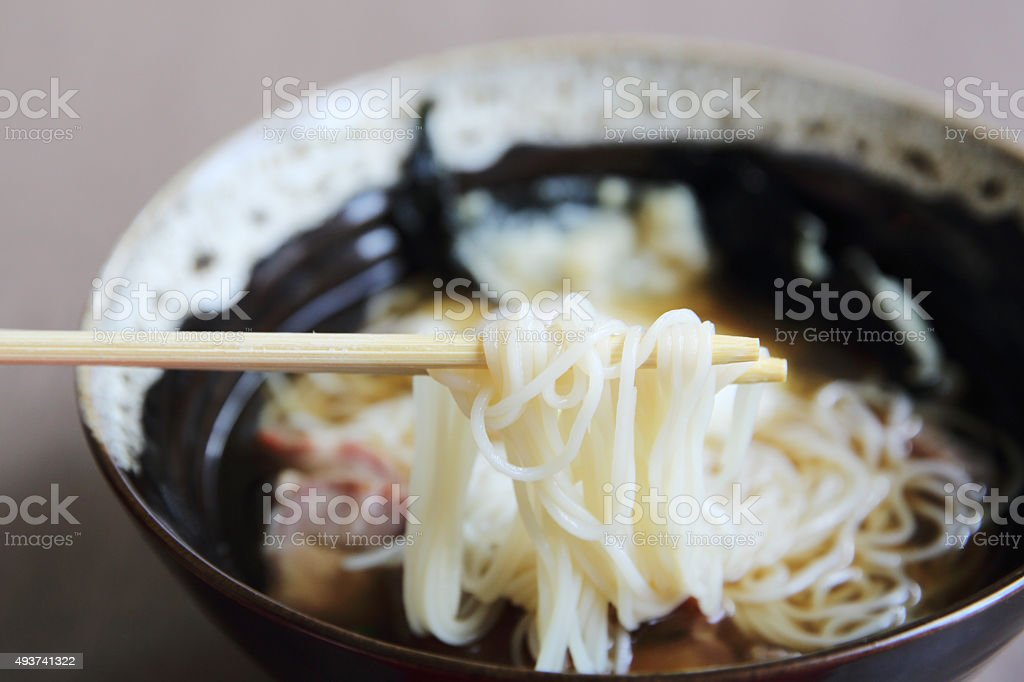 Noodle with pork and egg on wood background stock photo