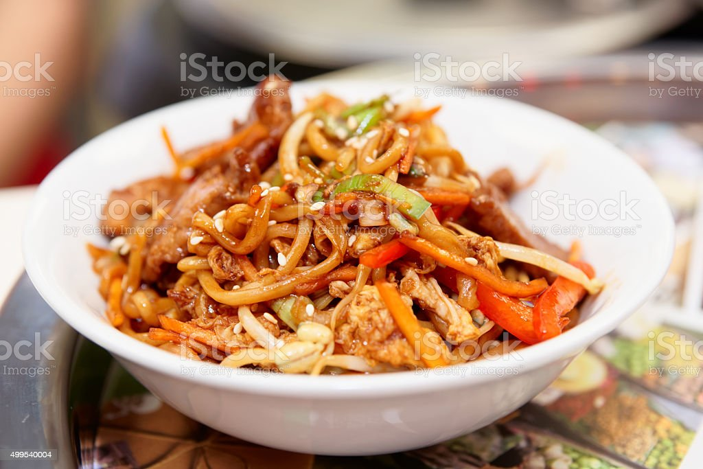 Noodles cooked in wok, asian food stock photo