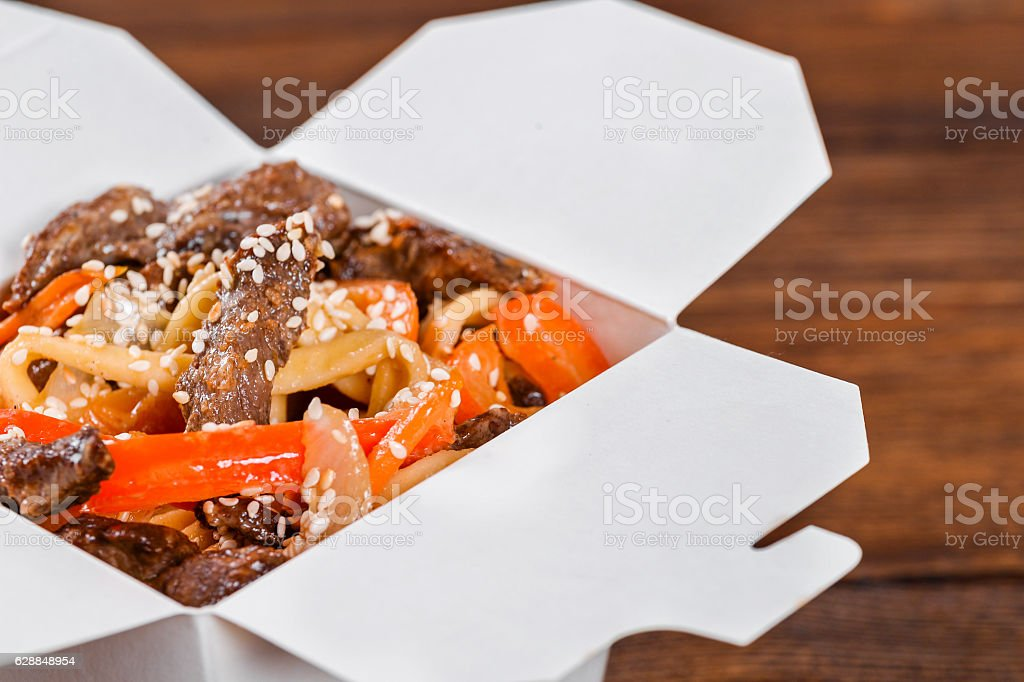 Noodles in a white box on wooden background stock photo