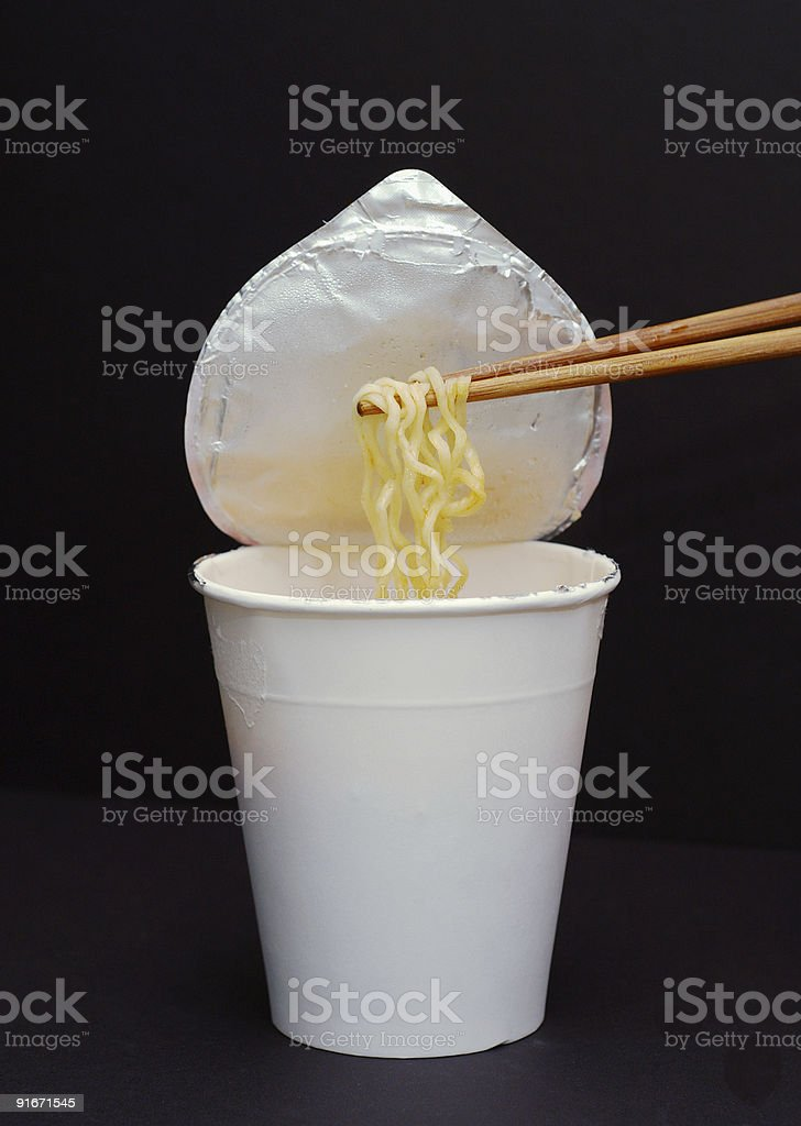 Noodles in the chopsticks royalty-free stock photo