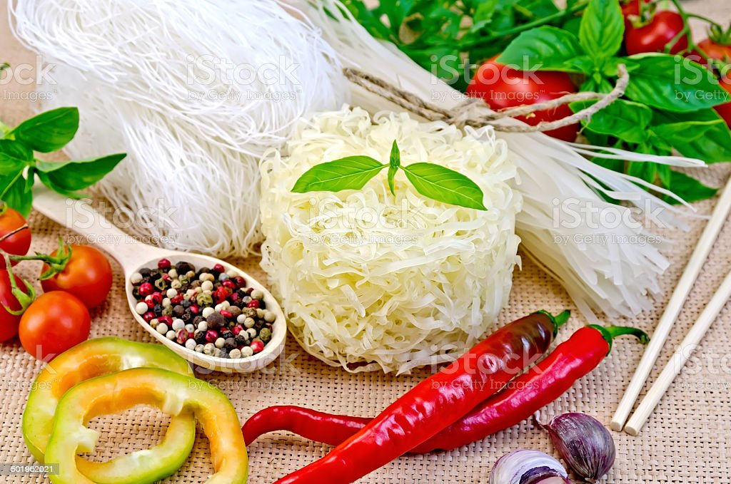 Noodles rice different with peppers and vegetables on sacking royalty-free stock photo