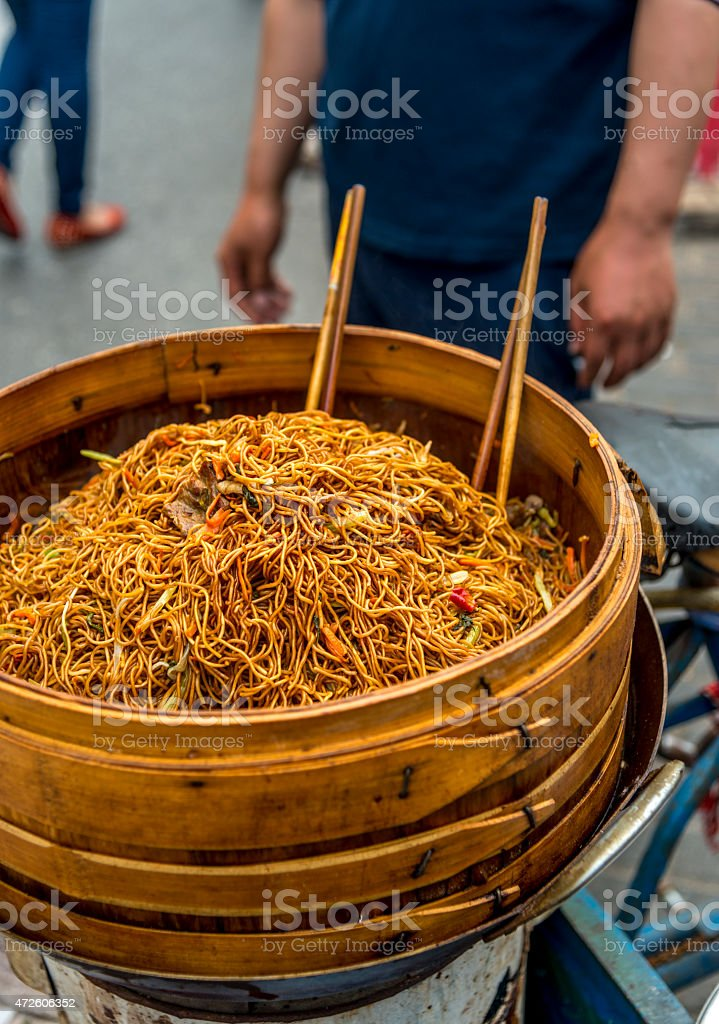Noodles street vendor in China, Shanghai. Food hawker stock photo