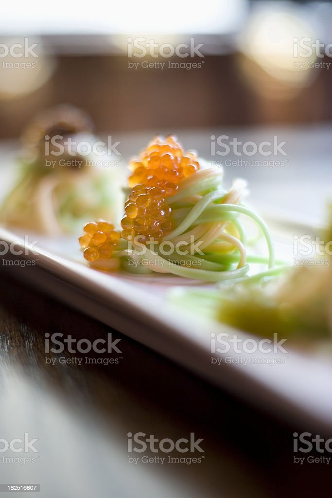Noodles topped with caviar stock photo