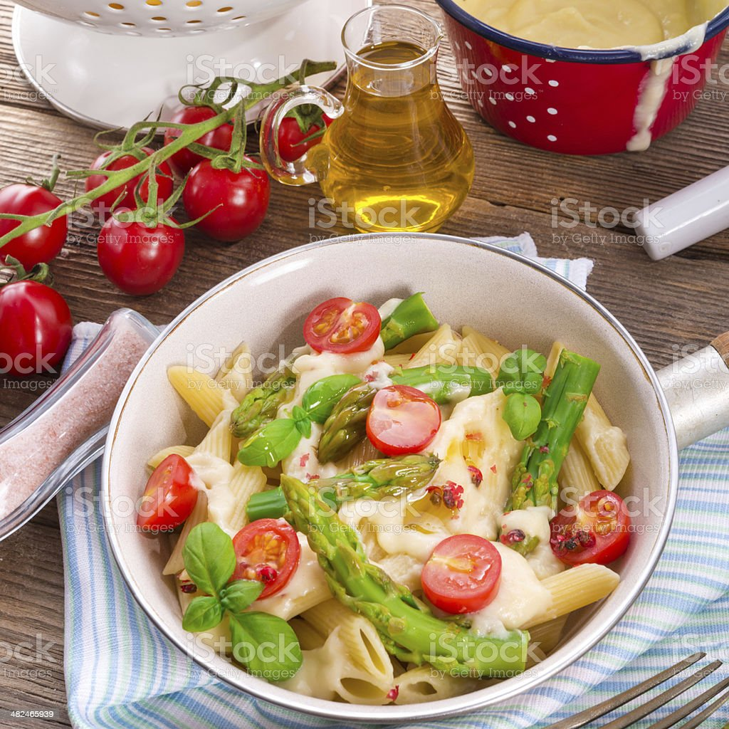 Noodles with asparagus in cream-cheese sauce royalty-free stock photo
