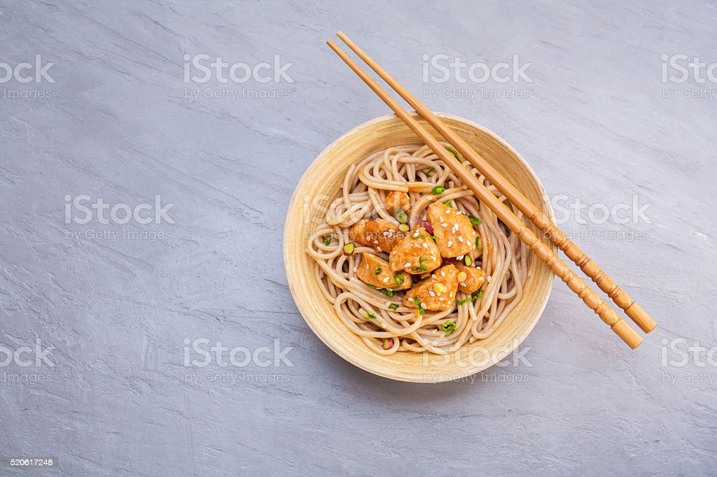 Noodles with chicken and sesame seeds stock photo