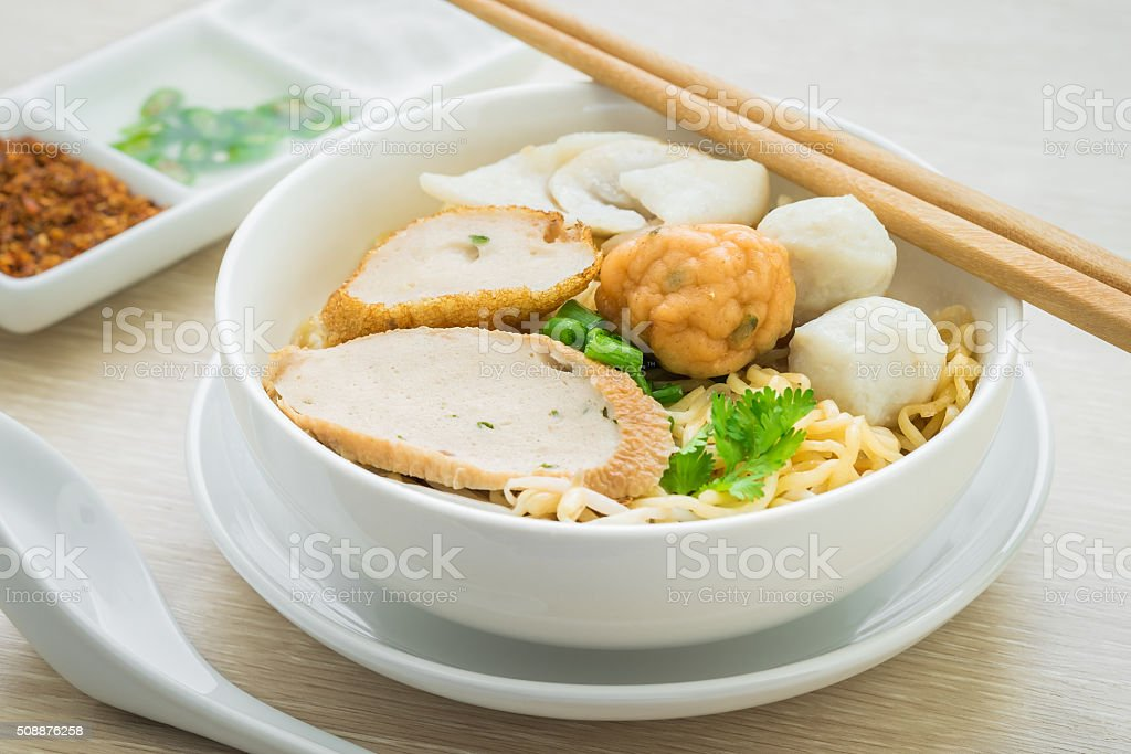 Noodles with fish balls in bowl stock photo