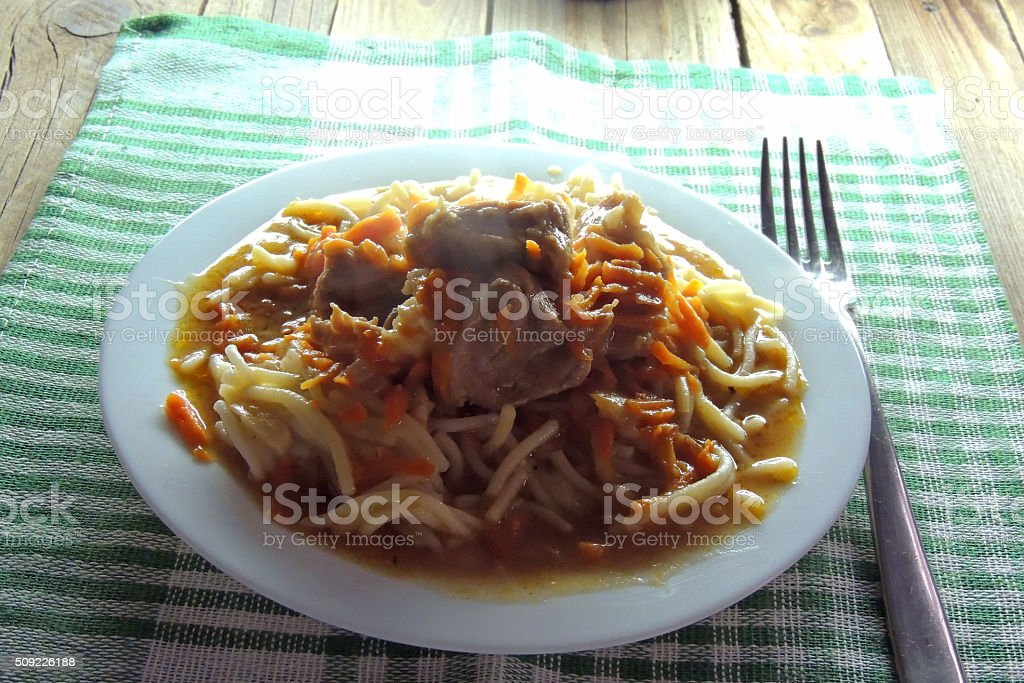 Noodles with gravy and meat stock photo