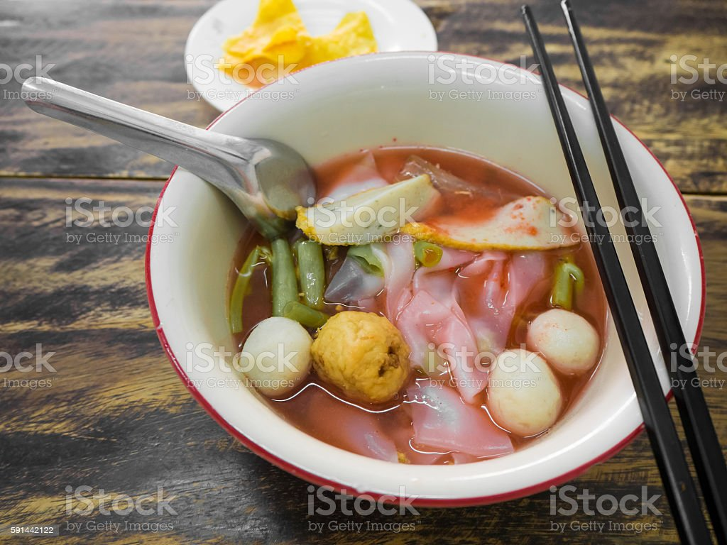 Noodles with seafood soup and red sauce. stock photo