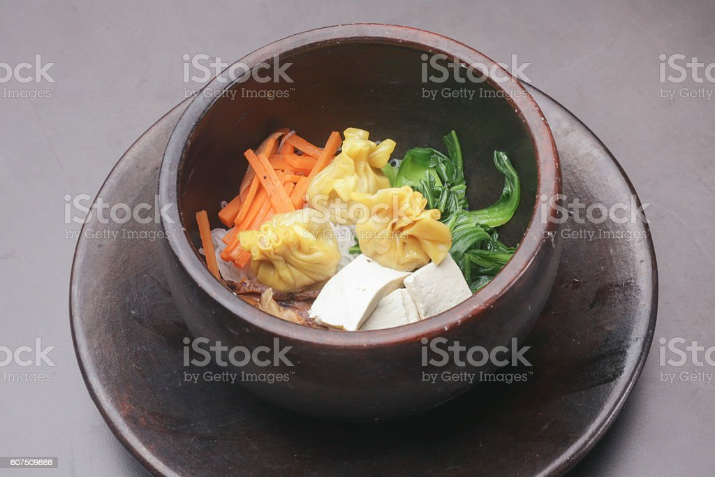 Noodles with vegetable and dumplings stock photo