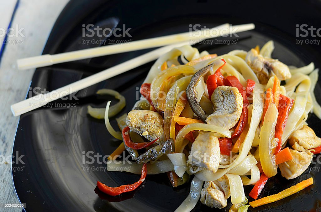 noodles with vegetables and chicken stock photo