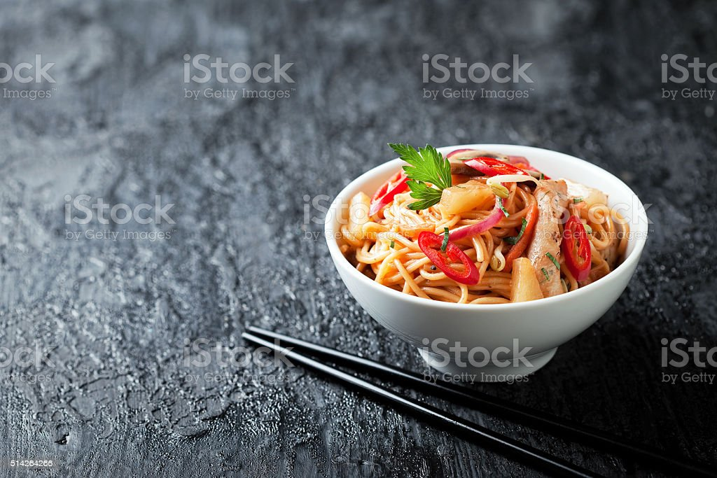 Noodles with vegetables, chicken and pineapple stock photo
