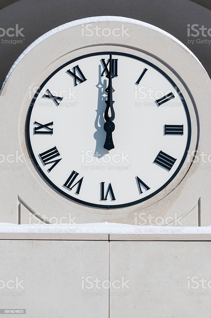 Noon Hour on a Clock stock photo