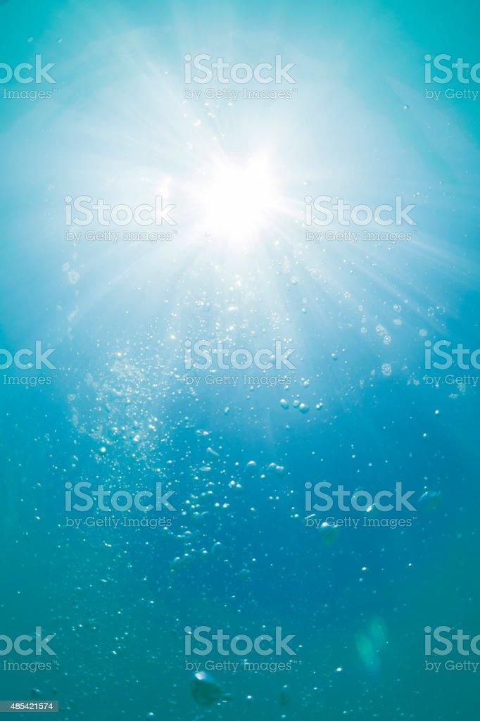 Noon sun glaring underwater stock photo