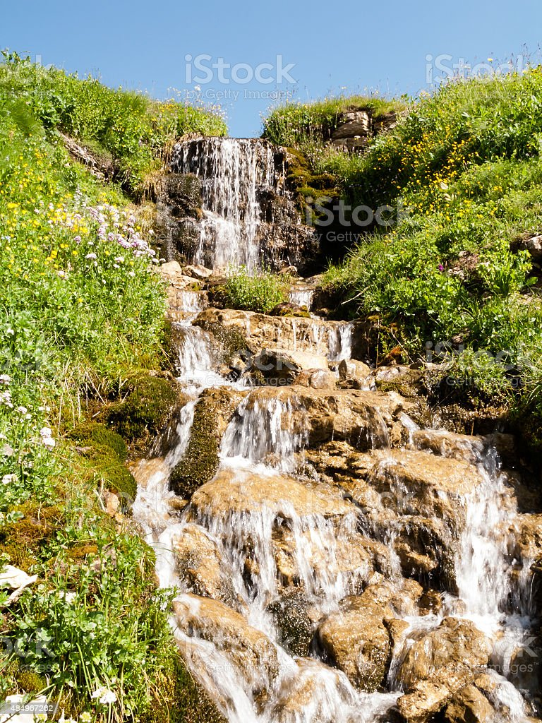 Noontime creek in the summer highland stock photo