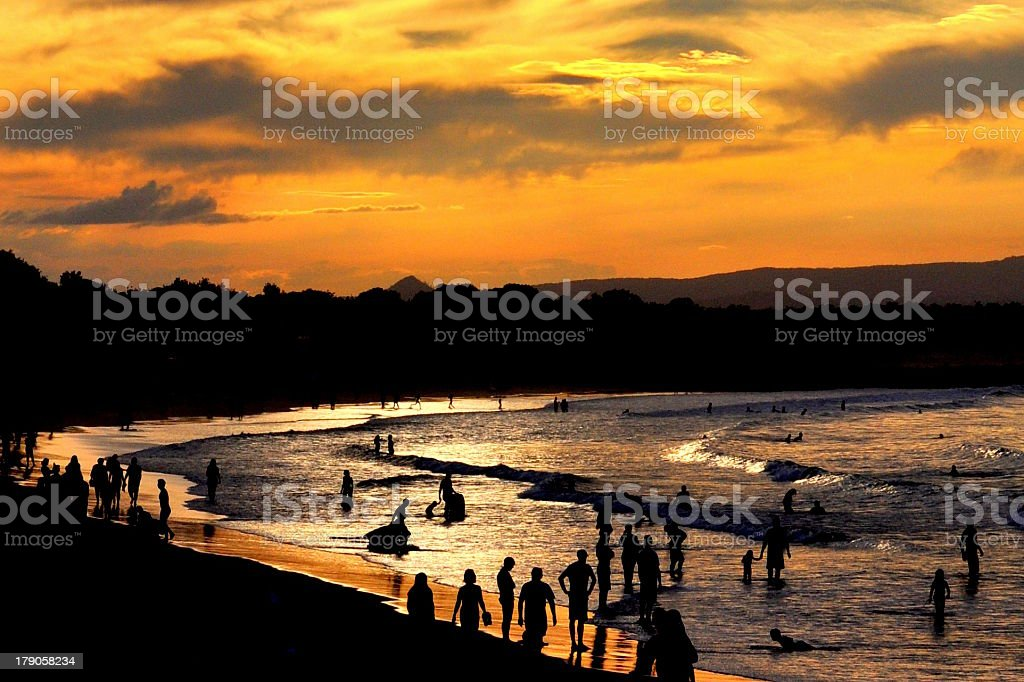 Noosa Main Beach Sunset Sillhouettes stock photo