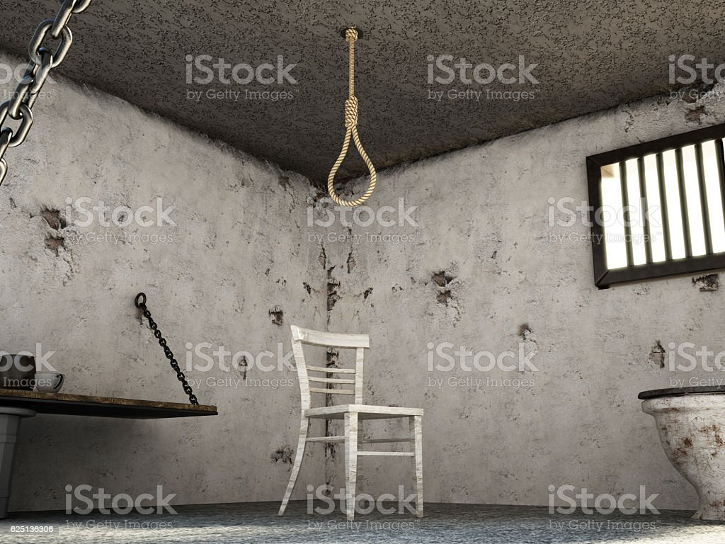 Noose and chair inside old prison cell stock photo