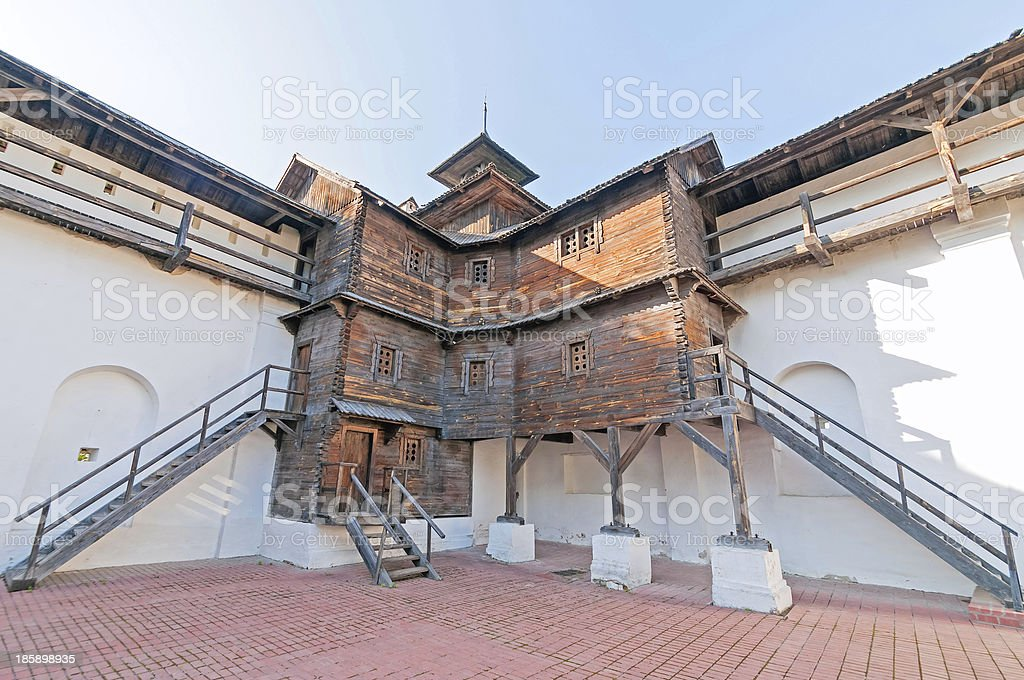 Nord wooden tower of Transfiguration monastery against blue sky background royalty-free stock photo