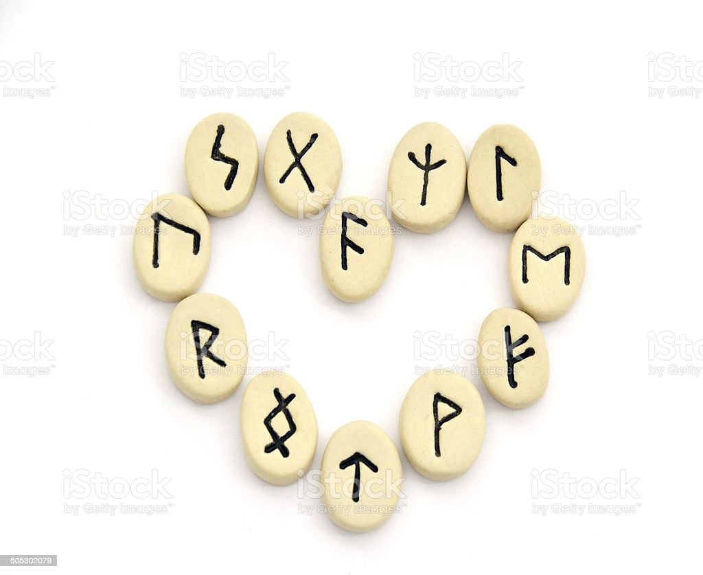 nordic runes - heart shape stock photo