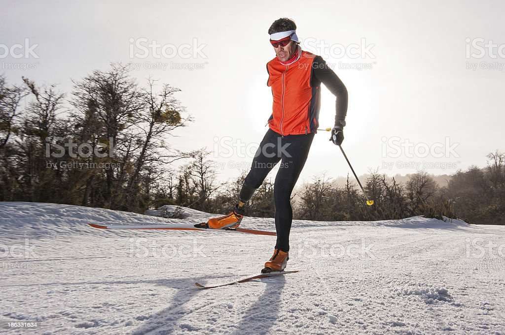 Nordic skier in action on snowy course stock photo