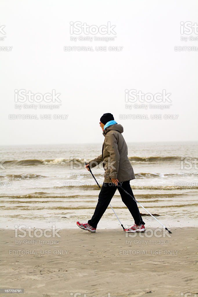 Nordic walking at North Sea stock photo