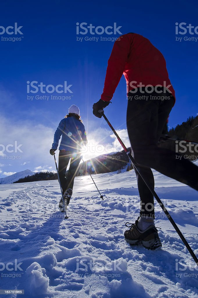 Nordic walking at winter time royalty-free stock photo