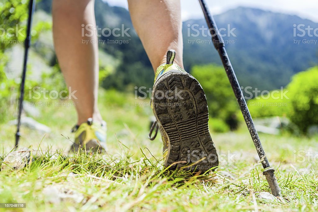 Nordic walking hiking sport shoes in mountains stock photo