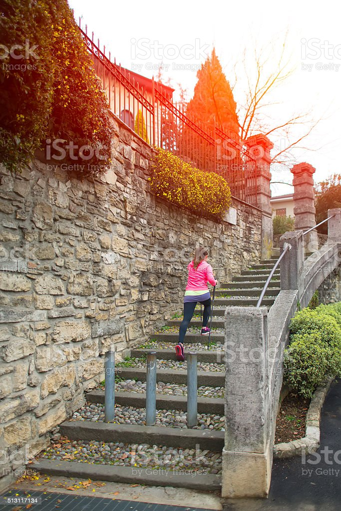 Nordic walking in a stairway in the city stock photo