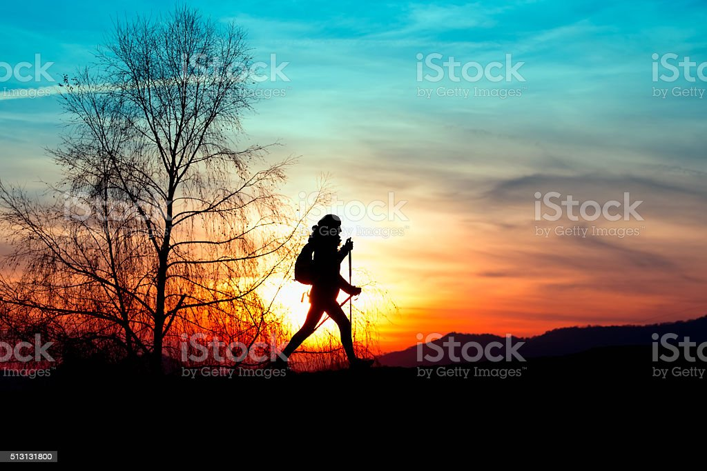Nordic walking in the mountains at sunset stock photo