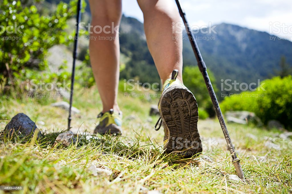 Nordic walking legs in mountains stock photo