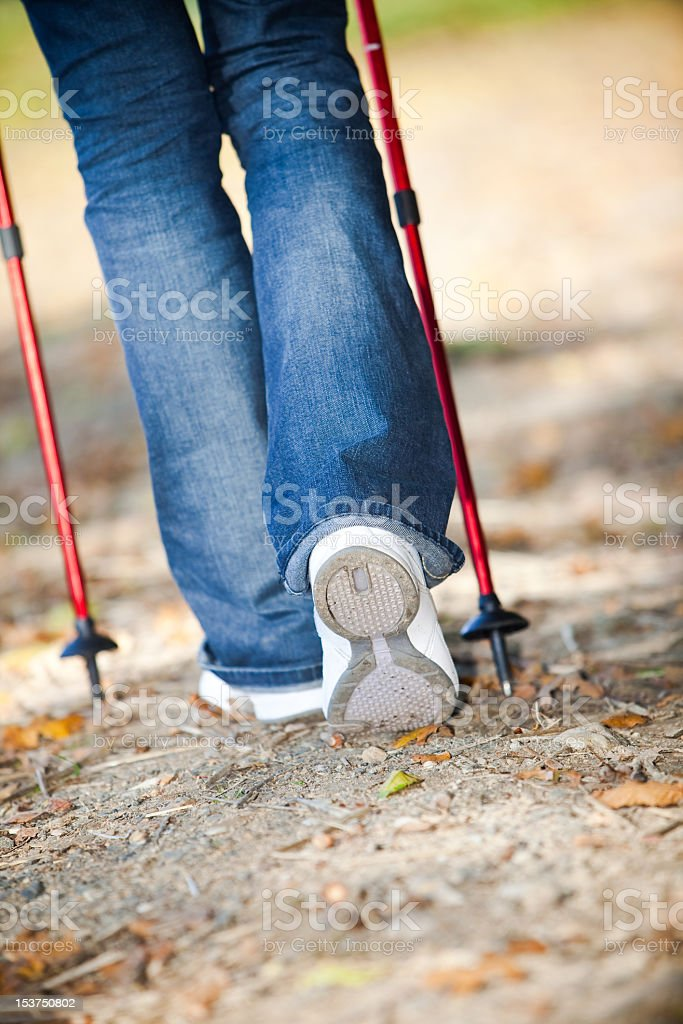 Nordic walking race on autumn trail royalty-free stock photo
