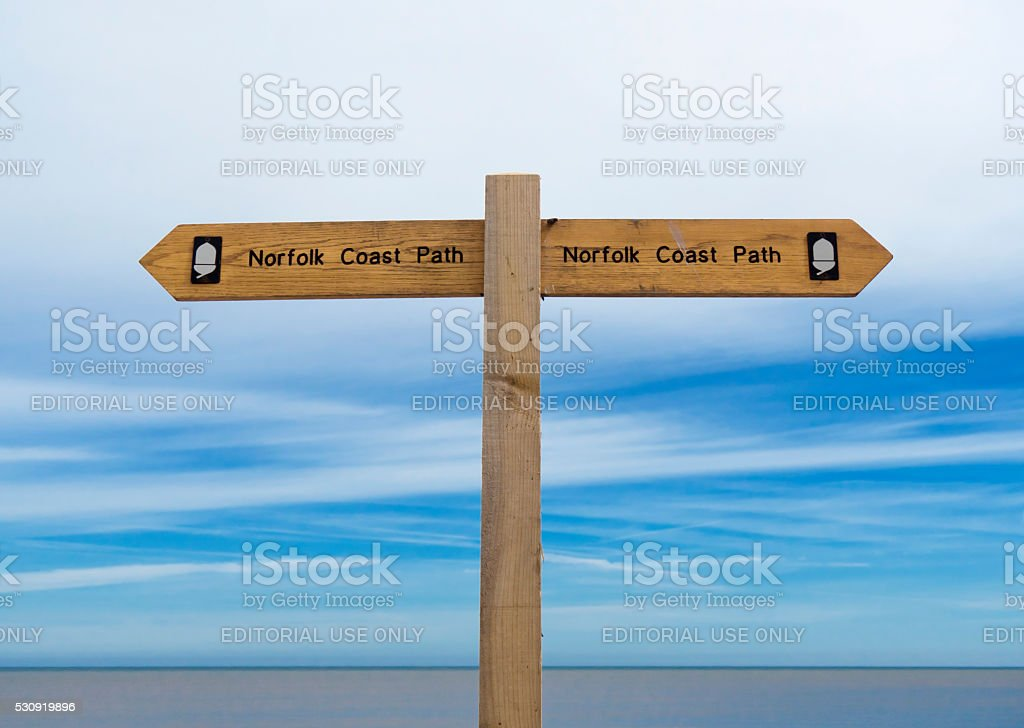 Norfolk Coast Path signpost by the sea stock photo