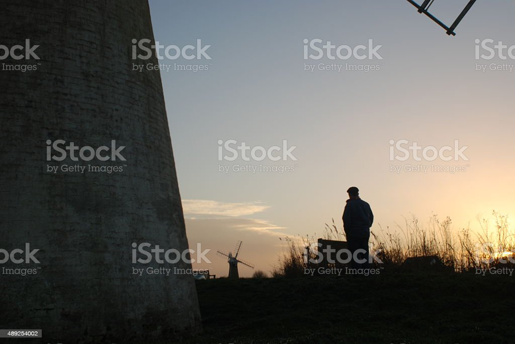 Norfolk sunset with two windmills stock photo