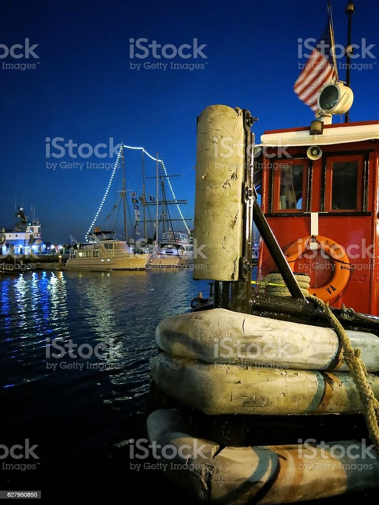 Norfolk, VA Tugboat, American Flag, Harbor Waterfront Schooner Ship Nighttime stock photo