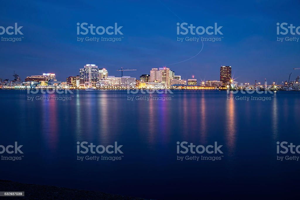 Norfolk, Virginia skyline and airline light trail at dusk. stock photo
