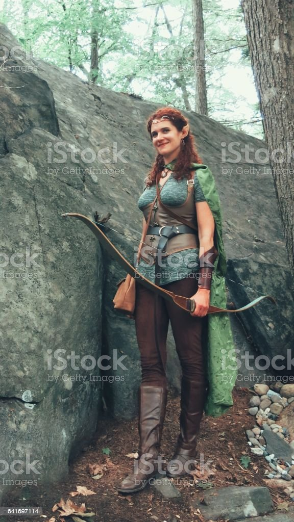 Norse Medieval Mythology, Tall Female Archer Elf in Forest Glade stock photo
