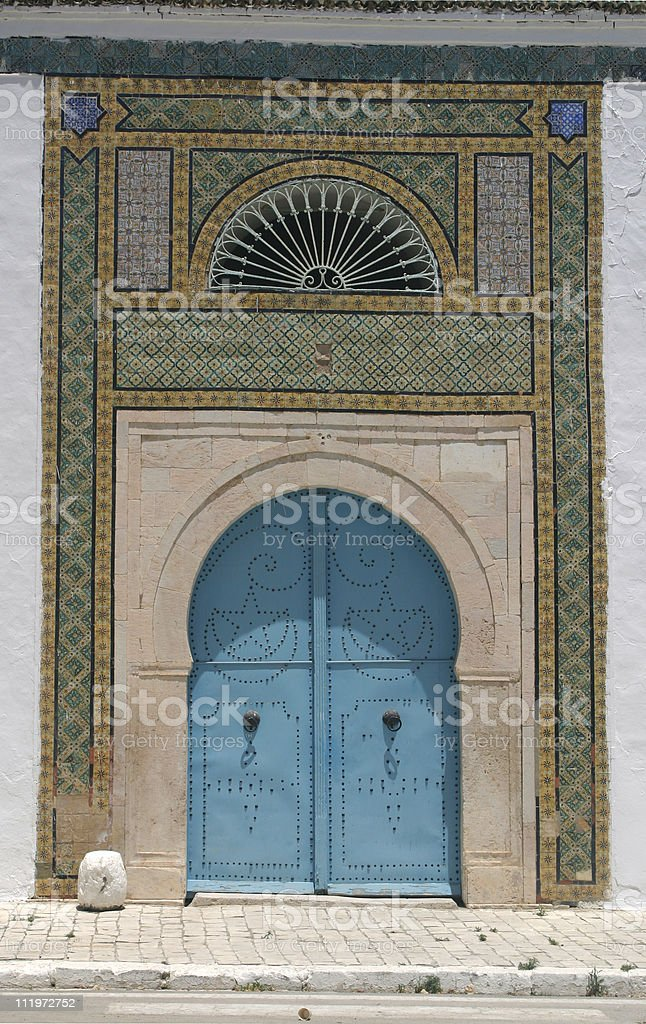 North African architecture - blue doors and ornaments, Tunisia royalty-free stock photo