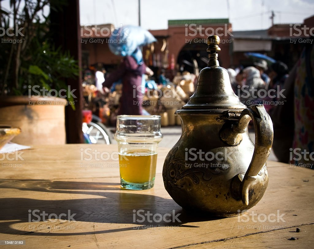 North African Green Tea, Teapot and Glass, City Life Background stock photo