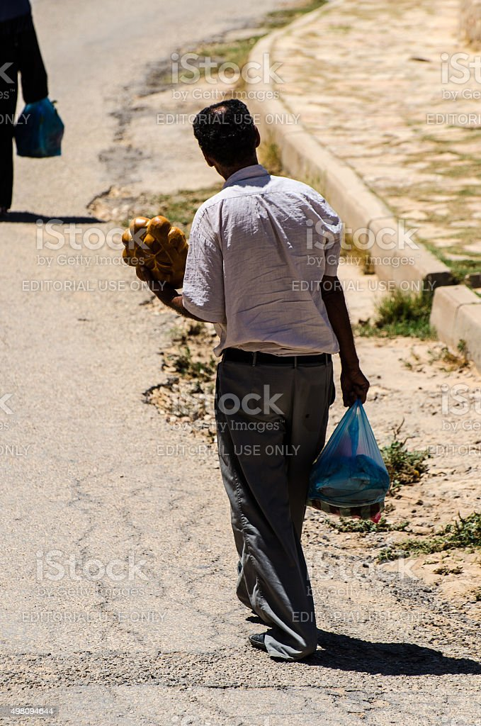 North African Man with bread stock photo