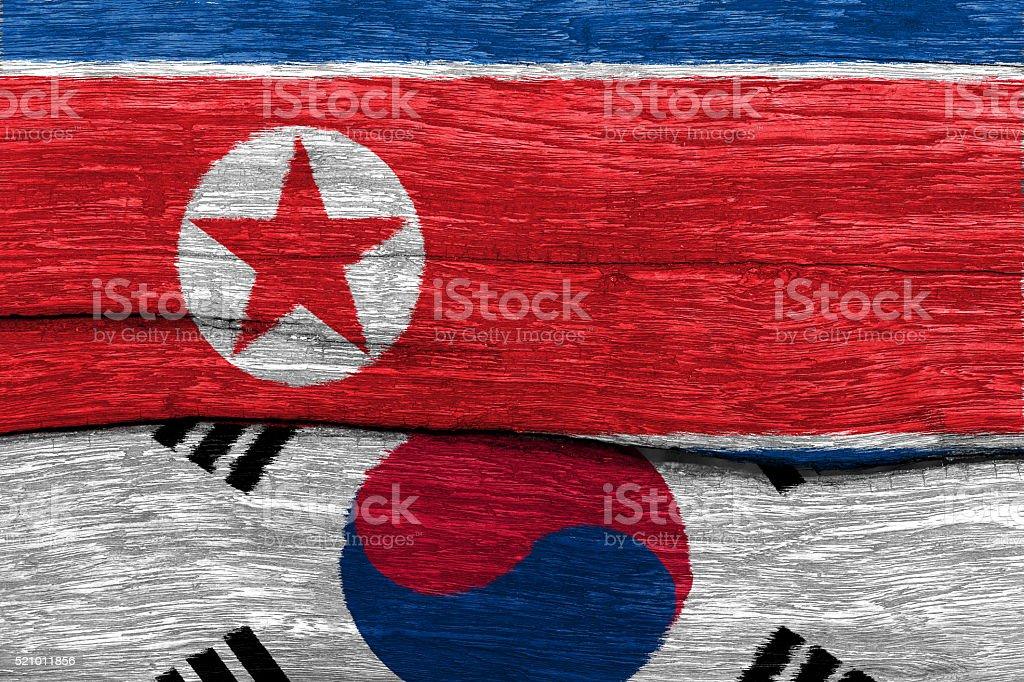 north and south korea flag on wood stock photo