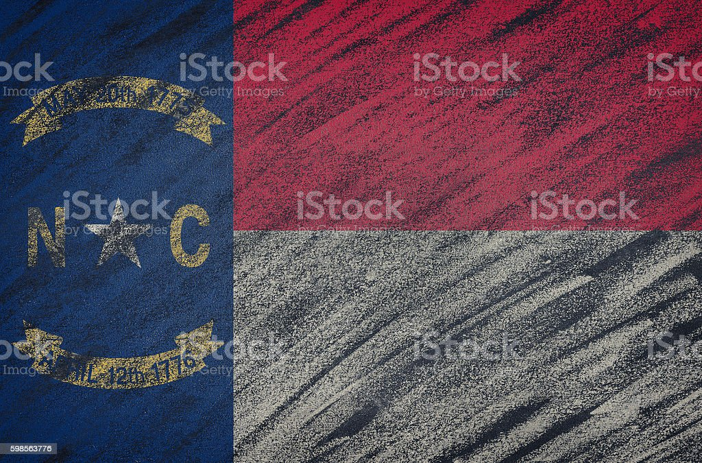 North Carolina flag painted with colored chalk on a blackboard. stock photo