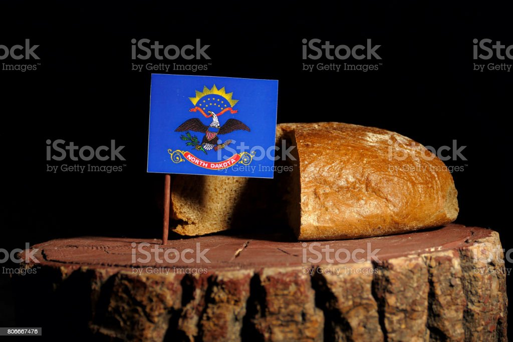 North Dakota flag on a stump with bread isolated stock photo