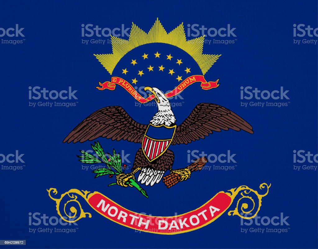 North Dakota flag with fabric texture stock photo