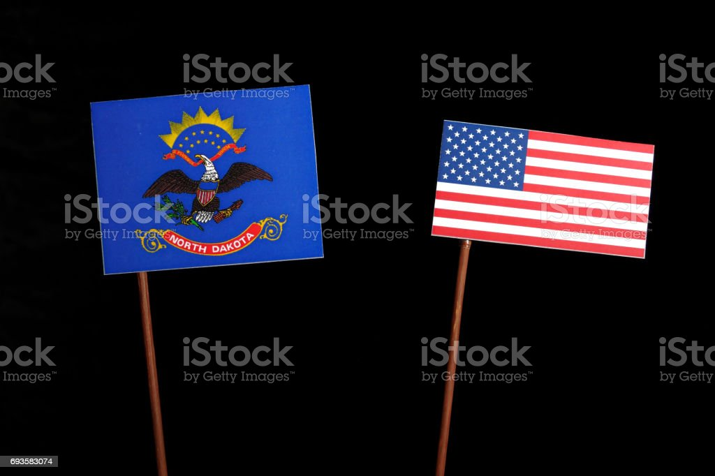North Dakota flag with USA flag isolated on black background stock photo