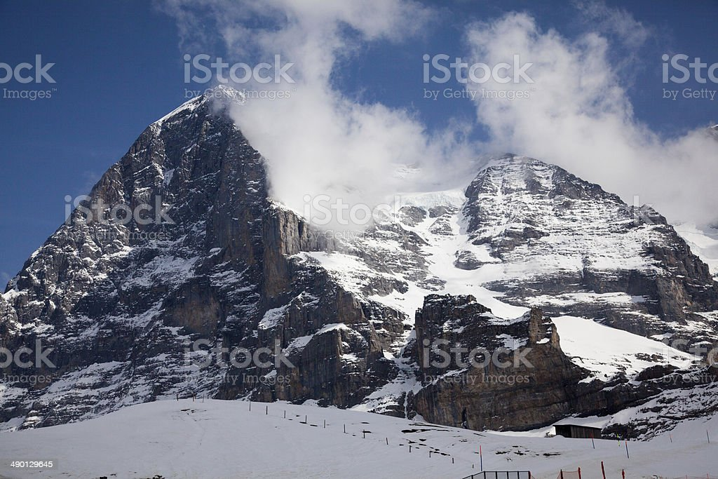 North Face Eiger cloud swirls over the mountain in Switzerland stock photo