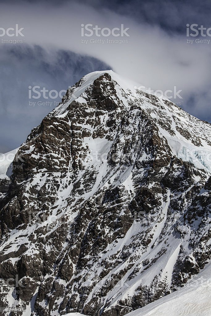 North Face Eiger cloud swirls over the mountain stock photo
