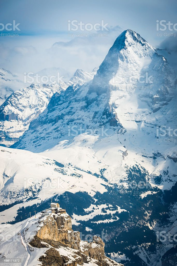 North Face Eiger towering over mountain cable car Alps Switzerland stock photo