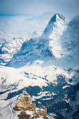 North Face Eiger towering over mountain cable car Alps Switzerland
