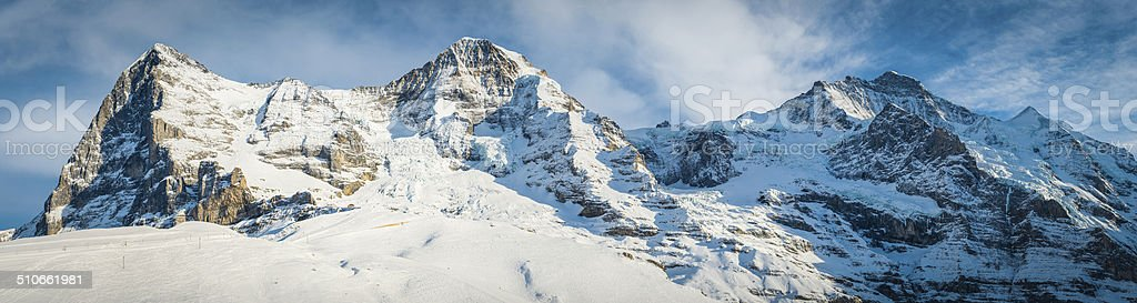 North Face of the Eiger and Jungfraujoch snowy Alpine mountains stock photo